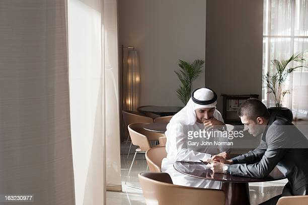 Two Middle Eastern Businessmen in  casual meeting