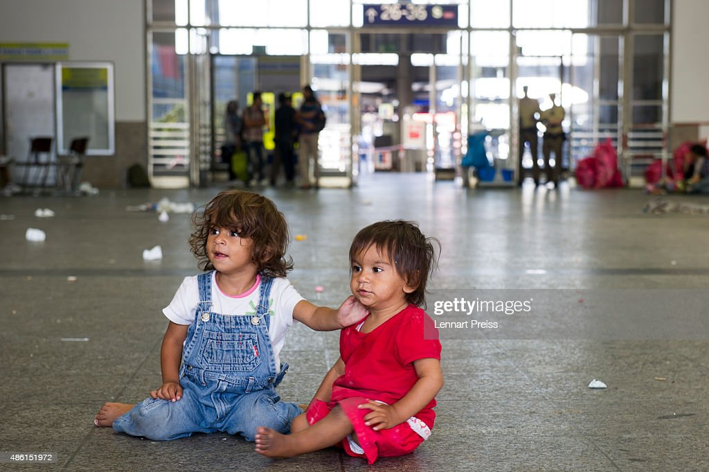 Two migrant girls play on the floor of a holding area after being detained by Police at Munich Hauptbahnhof main railway station and who had no passports or valid visas on September 1, 2015 in Munich, Germany. Over a thousand migrants arrived in southern Germany by train in the last 24 hours, many of them who boarded trains in Budapest. According to police hundreds of migrants are arriving in southern Germany daily, either via people smugglers from Hungary along the A3 highway or via trains coming from Italy. Germany is expecting to receive 800,000 asylum-seeking migrants this year and is struggling to cope with the record number.
