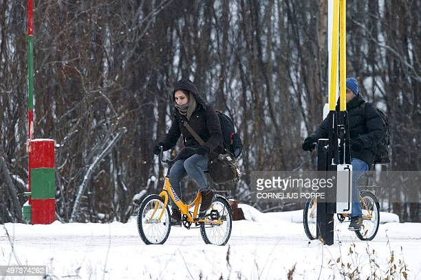 Two migrants on bikes cross the boarder between Norway and Russia in Storskog near Kirkenes in Northern Norway on November 16 2015 An increasingly...