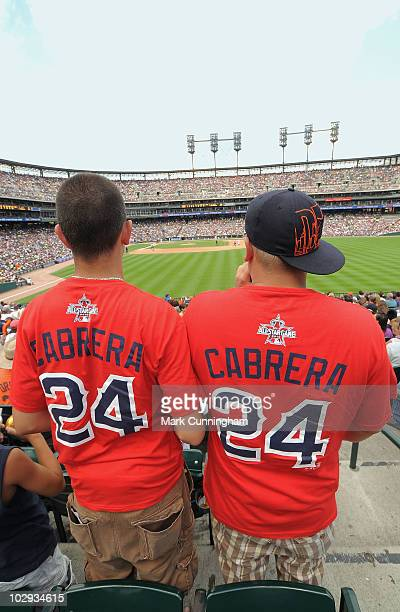 Two Miguel Cabrera of the Detroit Tigers fans stand up in the outfield stands wearing their 2010 AllStar Game replica jerseys during the game against...