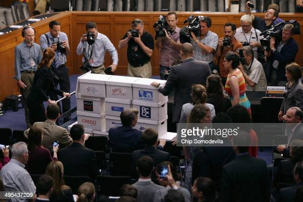 Two million boxed petitions are wheeled into a hearing room in the Hart Senate Office Building before a Senate Judiciary Committee hearing about...