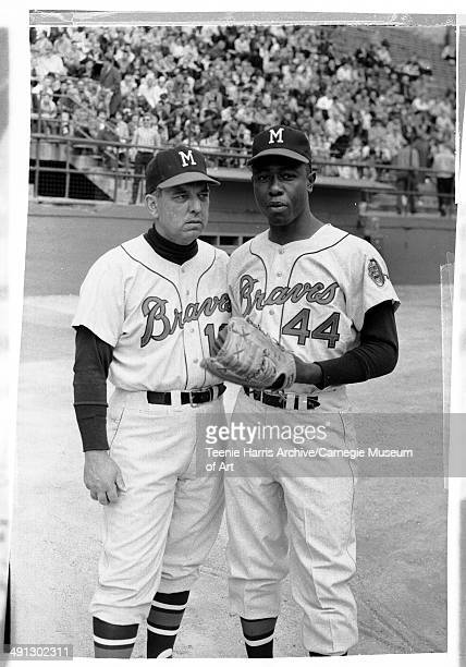 Two Milwaukee Braves baseball players including no 44 Hank Aaron posing at Forbes Field Pittsburgh Pennsylvania circa 19611970
