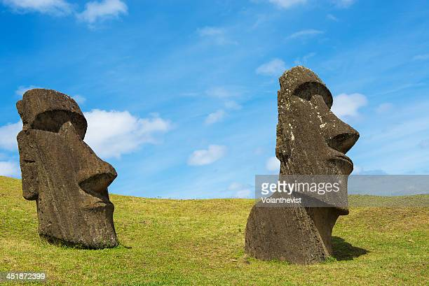 Two Moai buried to the neck in Rano Raraku