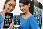 Two models display the Apple iPhone 5 during the product's release at a store in Taipei on December 14 2012 Three main telecom companies released the...
