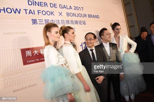 Two models Managing Director of Chow Tai Fook Kent Wong and Adrian Cheng executive director of Chow Tai FookÊattend the Chow Tai Fook Jewellry Show...