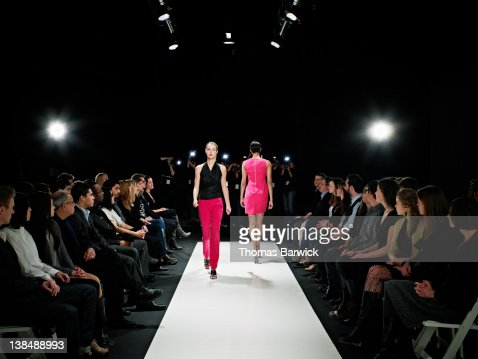Two models on catwalk during fashion show
