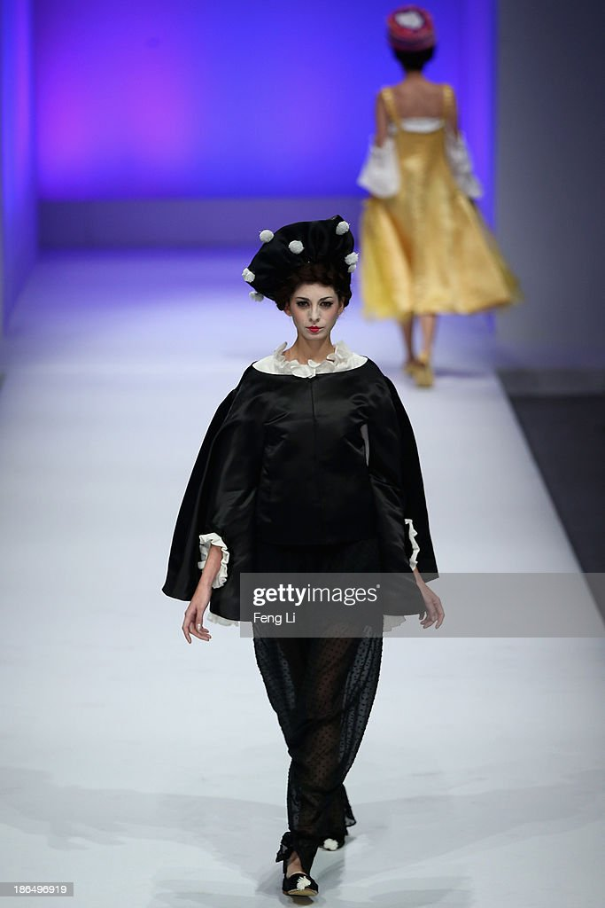 Two models showcase designs by Chinese designer Cao Qinghe on the runway at HEMPEL Designer Salon Collection show during Mercedes-Benz China Fashion Week Spring/Summer 2014 at 751 D-PARK Central Hall on October 31, 2013 in Beijing, China.