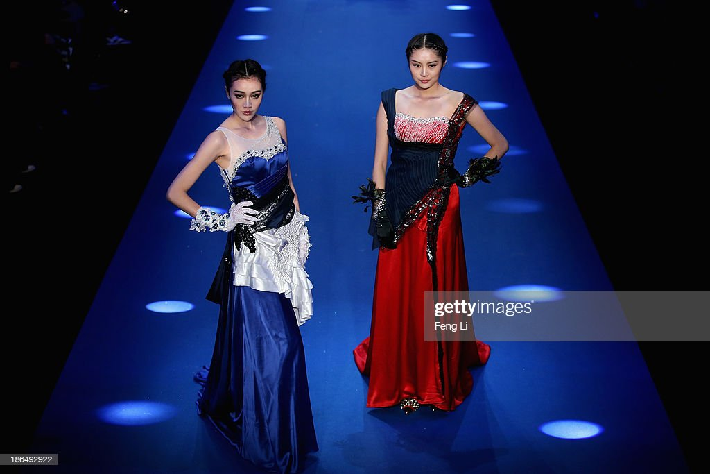 Two models showcase designs on the runway at 2014 Gioia Pan & Mark Cheung Collection show during Mercedes-Benz China Fashion Week Spring/Summer 2014 at 751 D-PARK Workshop on October 31, 2013 in Beijing, China.