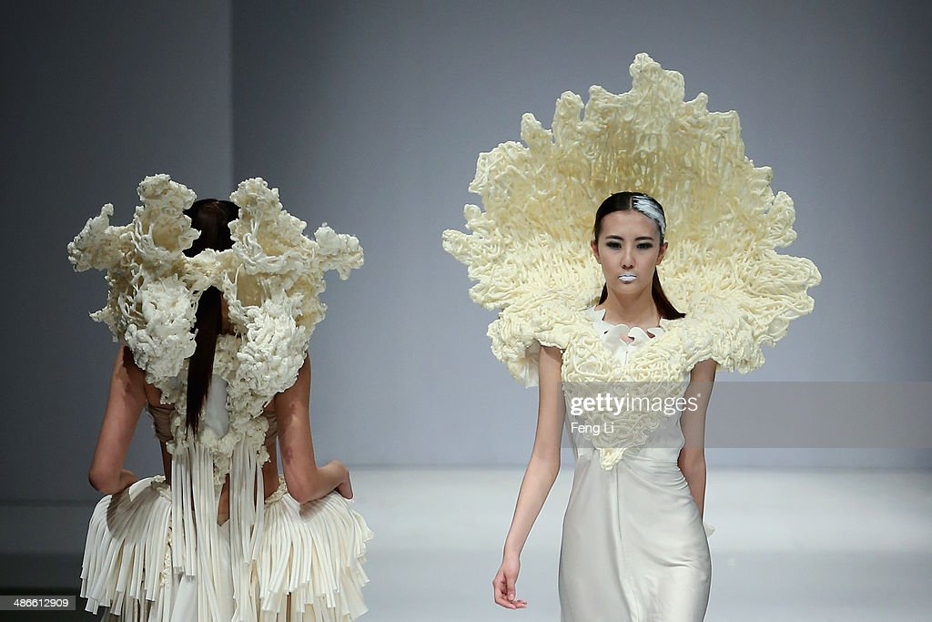 Two models showcase designs with the creative of noodles on the runway at the School of Arts Soochow University Graduates Show during the 2014 China Graduate Fashion Week at the 751D.Park Central Hall on April 25, 2014 in Beijing, China.