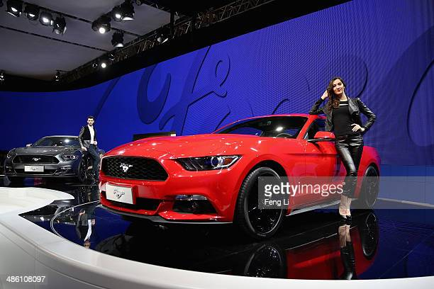 Two models stand beside two Ford concept sport cars during the 2014 Beijing International Automotive Exhibition at China International Exhibition...