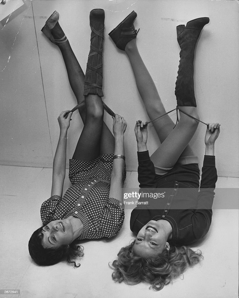 Two models wearing the new autumn range of Mary Quant shoes and boots at Mary Quant's Ginger Group South Molton Street London Anne Goddet wears 'Pin...