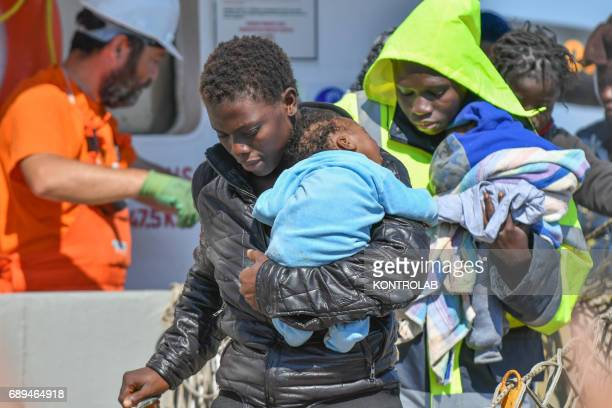 Two moms with their children during the landing of migrants by Turkish cargo ship Kaptan Hilmi III in port of Corigliano Calabria southern Italy The...