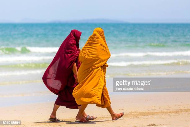 Two monks on the beach in Sihanoukville city (Cambodia)