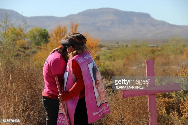Two mothers of killed women embrace during a protest on the eve of the International Day for the Elimination of Violence Against Women on November 24...