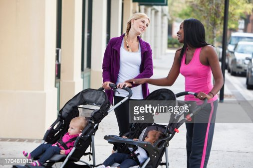 Two mothers with babies in strollers