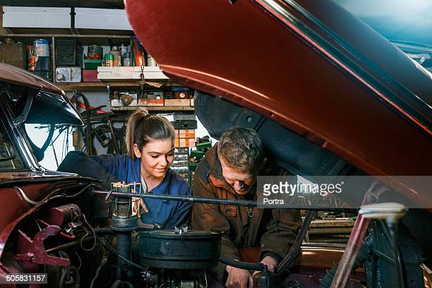 Two motor mechanics focusing on work.