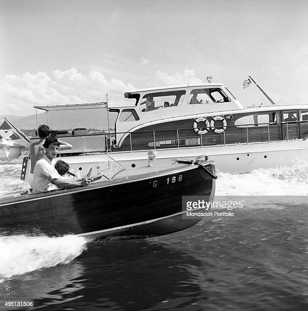 Two motorboats travelling side by side on Lake Geneva during the Summit to discuss global security German unification and disarmament Geneva 18th...