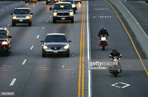 Two motorcyclists drive in the High Occupancy Vehicle lane also called the diamond or commuter lane on the 118 or Ronald Reagan Freeway on February 3...