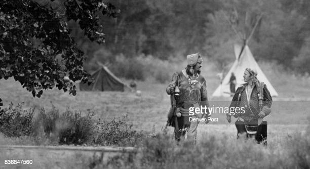 Two mountain men make their way from the primitive camping area to the shooting range at skunk hollow in bear creek park People dress in period...