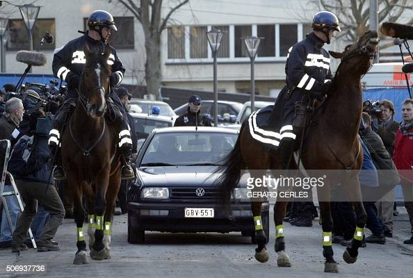Two mountedhorse policemen escort the car of Pol Marchal father of An Marchal one of the victims of Marc Dutroux as it leaves the Arlon courthouse 02...