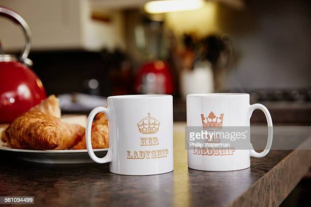 Two mugs on table, close up