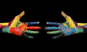 Two Multi Color painted hands coming to each other.