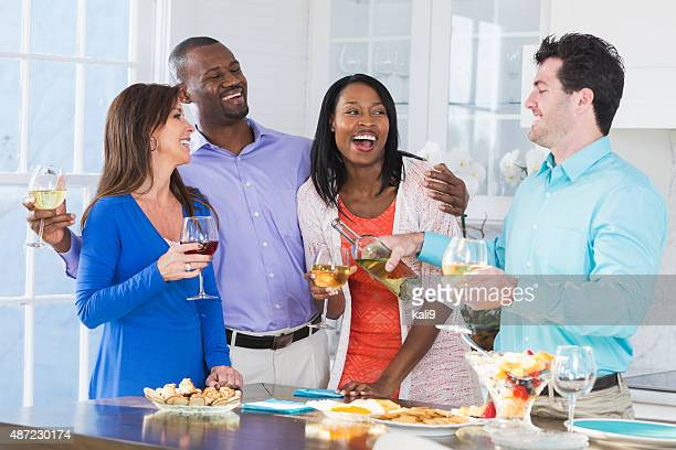 Two multi-ethnic couples enjoying wine and appetizers