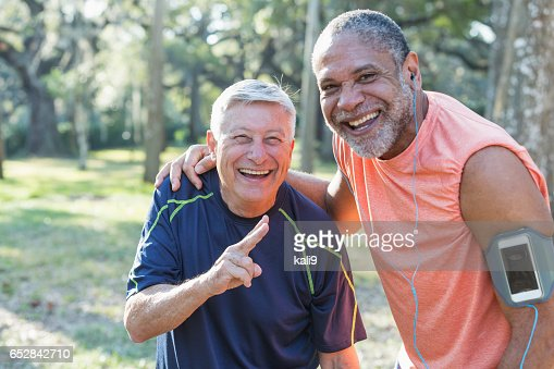 Two multi-ethnic senior men exercsing in the park : Stock Photo