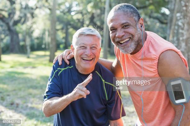 Two multi-ethnic senior men exercsing in the park