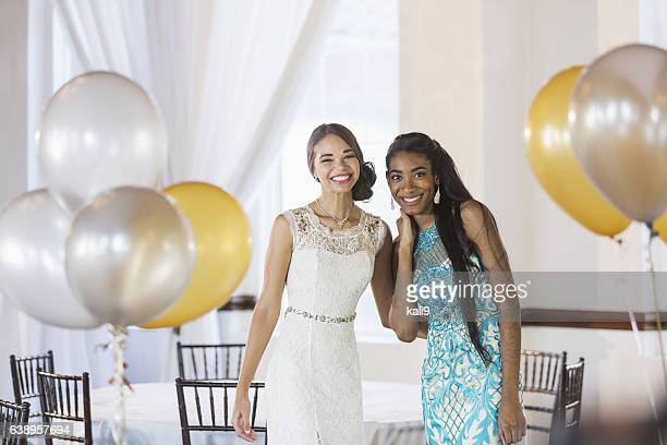 Two multi-ethnic teenage girls dressed for special event