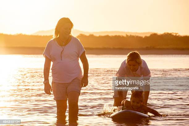 Two mum's help daughter surfing