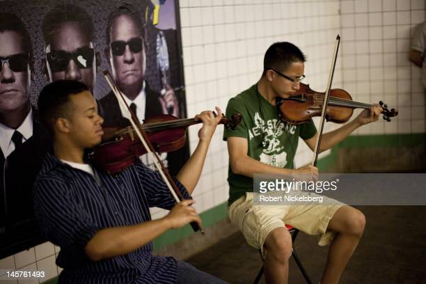 Two musicians play classical music on their violins May 31 2012 on a subway platform in New York City In 2011 New York's subway system delivered an...