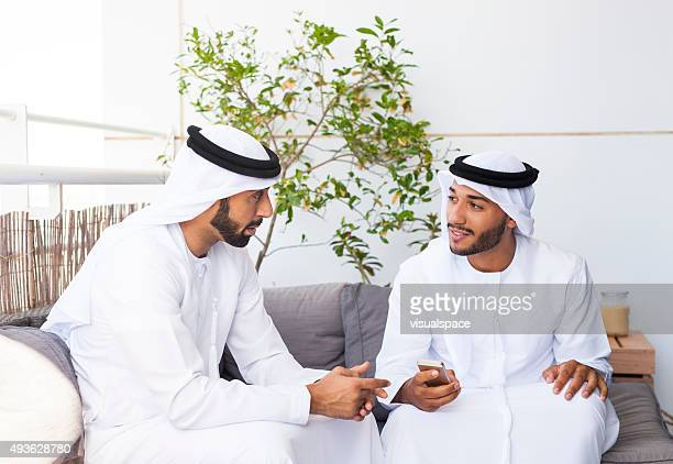 Two Muslim Men Discussing Business in a Lounge Area