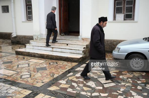Two Muslim Tatar men arrive for Friday midday prayers at the KebirDzhami Mosque which is the city's oldest on March 7 2014 in Simferopol Ukraine...