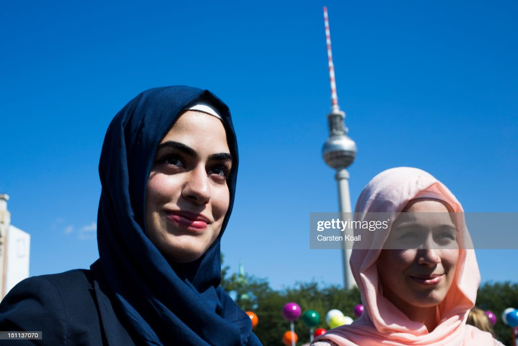 Two muslim women pass on the event 'About Berlin - religions make history' of historical significance as the broadcast tower at Alexanderplatz is visible behind 1, 2012 in Berlin, Germany. The event is part of the events ahead of Berlin's 775th anniversary, which the city will mark with a celebration scheduled for the end of October.