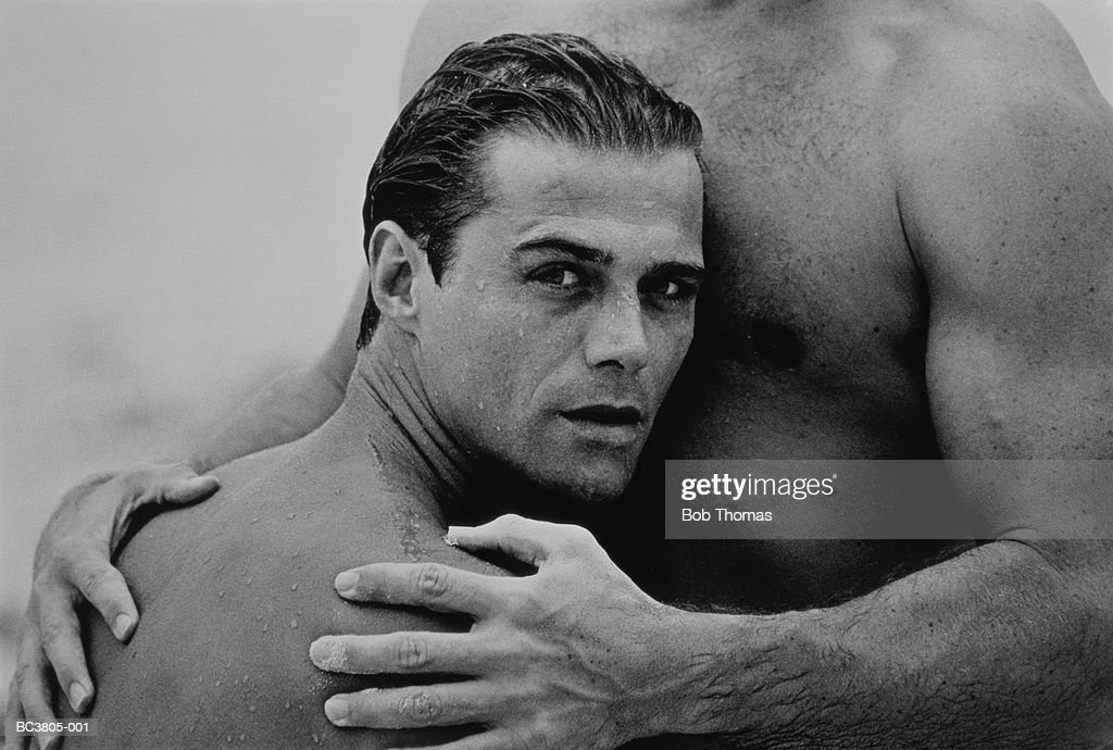 Two naked men embracing, close-up, section (B&W) : Stock Photo