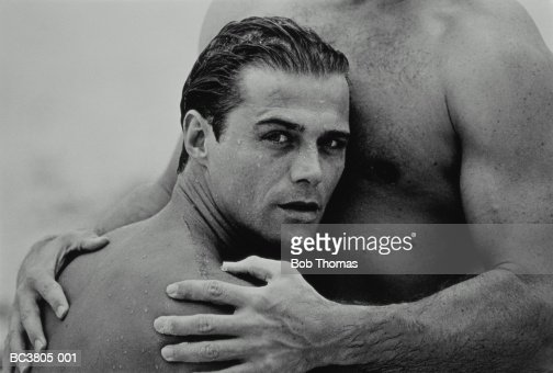 Two Naked Men Embracing Closeup Section Stock Photo