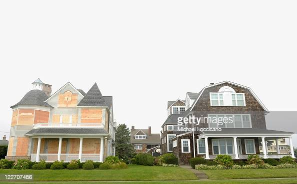 Two neighboring houses prepared differently in the wake of Hurricane Irene on August 28 2011 in Spring Lake New Jersey Hurricane Irene killed at...
