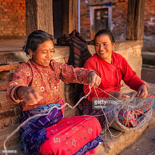 Two Nepali women  spinning a wool in Bhaktapur, Nepal