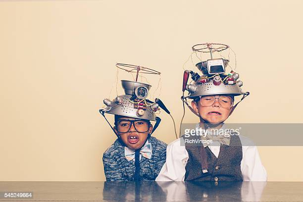 Two Nerd Boys Show Distress with Mind Reading Helmets