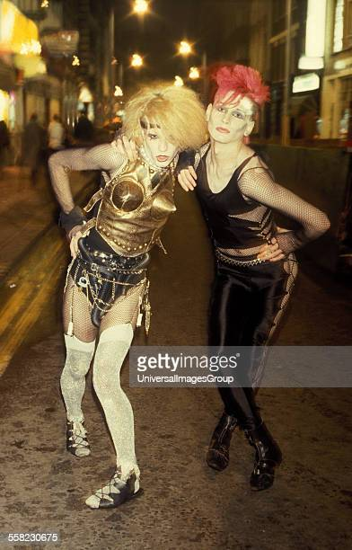 Two New Romantic Goths posing outside Alice In Wonderland Soho London UK 1984