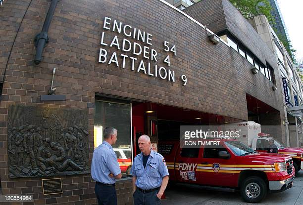 Two New York City firemen outside a Times Square fire station August 5 2011 in New York The New York Fire Department one of the Big Apple's most...