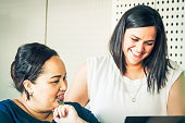 Close up image of two New Zealand business woman working together in an office environment in Auckland.