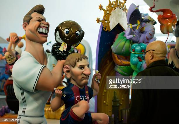 Two 'ninots' representing Real Madrid's Portuguese forward Cristiano Ronaldo and Barcelona's Argentinian forward Lionel Messi are on display in...