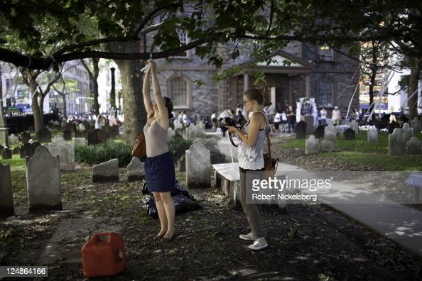 Two Norwegian women tie Ribbons of Remembrance on a tree limb outside St Paul's Chapel September 9 2011 honoring the 2753 people who perished during...