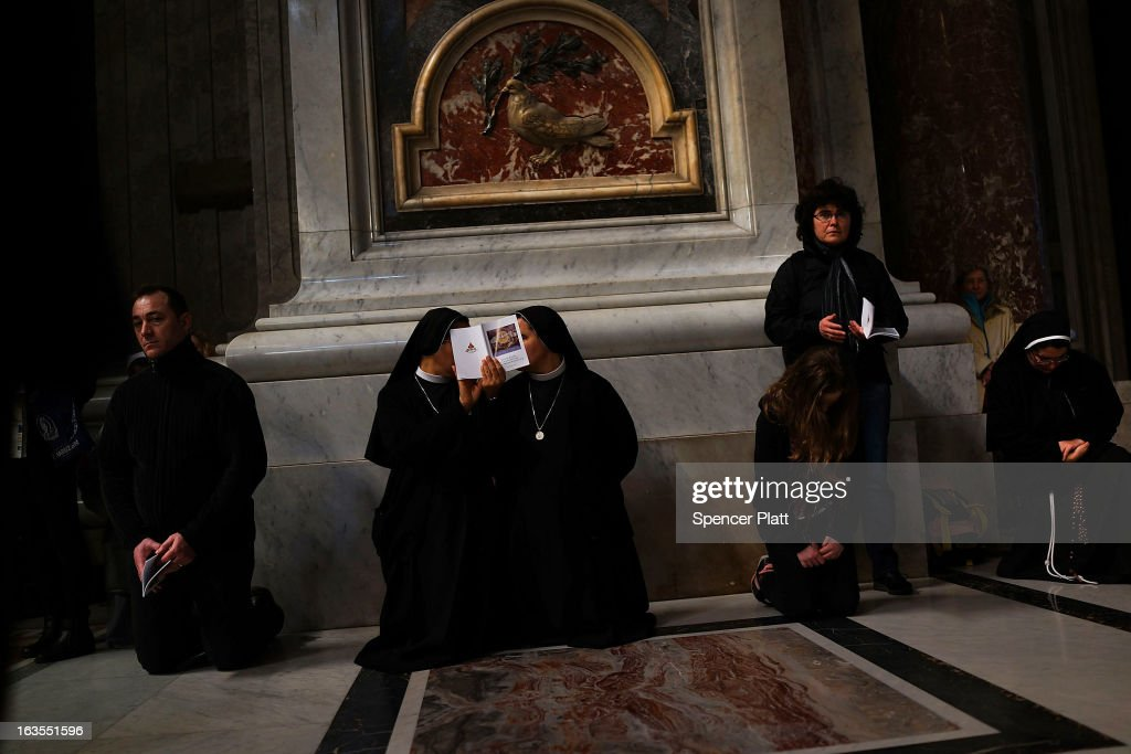 Two nuns attend the Pro Eligendo Romano Pontifice Mass at St Peter's Basilica, after which Cardinals will enter the conclave to decide who the next pope will be on March 12, 2013 in Vatican City, Vatican. Cardinals are set to enter the conclave to elect a successor to Pope Benedict XVI after he became the first pope in 600 years to resign from the role. The conclave is scheduled to start on March 12 inside the Sistine Chapel and will be attended by 115 cardinals as they vote to select the 266th Pope of the Catholic Church.