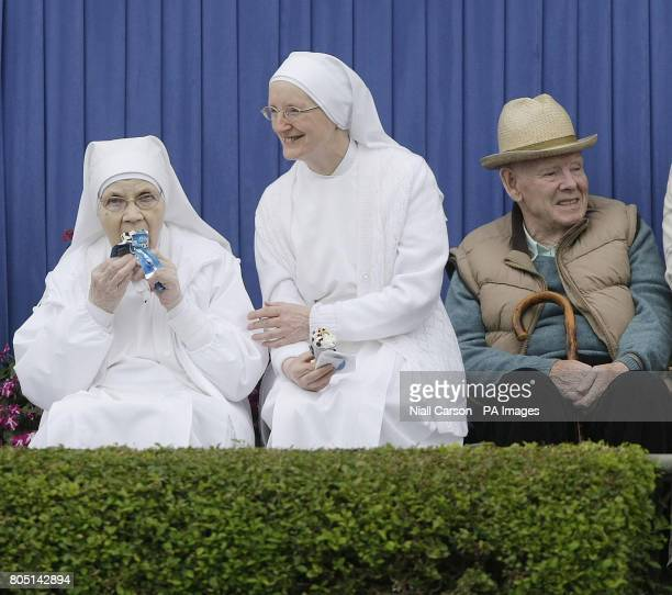 Two nuns enjoy an ice cream during the Aga Khan Challenge cup during the Dublin Horse Show at the RDS Dublin