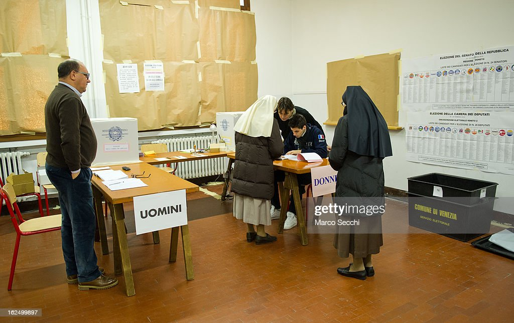 Two nuns present their Electoral Cards ahead of voting at a Polling Station in Venice Castello as the Italian General Election gets underway on February 24, 2013 in Venice, Italy. Italians are heading to the polls today to vote in the elections, as the country remains in the grip of economic problems . Pier Luigi Bersani's centre-left alliance is believed to be a few points ahead of the centre-right bloc led by ex-Prime Minister Silvio Berlusconi.