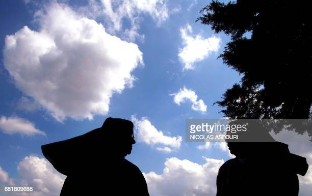 Two nuns speaks about the Pope health condition at the Fatima Sanctuary in Fatima 140 km north of Lisbon 01 April 2005 Pope John Paul II received the...