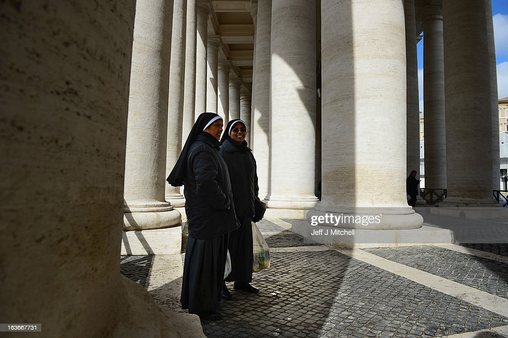 Two nuns stand in the colonnade in St Peter's Square on March 14, 2013 in Vatican City, Vatican. A day after thousands gathered in St Peter's Square to watch the announcement of the first ever Latin American Pontiff it has been announced that Pope Francis inauguration mass will be held on March 19, 2013 in Vatican City.